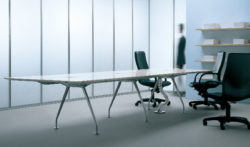 Modern white table with chrome base power and data